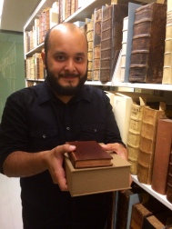 If I look nervous, it's because I am holding the most valuable books in the collection.
