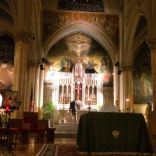 Lighting the altar candles  at the beginning of Adoration.