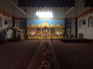 A row of flowers divides the temple down the middle. Women sit on the left, men on the right.
