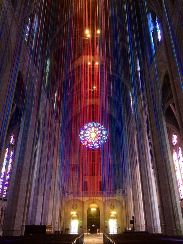 The rose window through the Ribbons of Light, a temporary art installation.