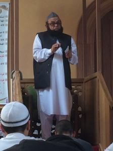 The Imam preaches.