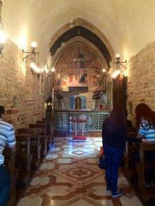 Visitors praying at the Porziuncola.
