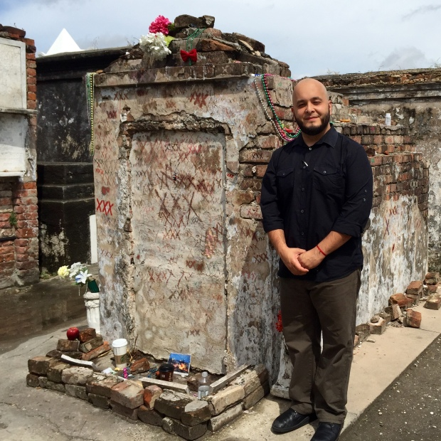 Aside from the XXX markings, this tomb is unmarked. Our tour guide assures us this is where Laveau is actually buried. The XXX markings are left by practitioners and devotees, they are petitions to Laveau. At the foot of the tomb we see various offerings and artifacts.