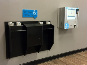 Old world and new world tithing! Automated Tithing Machine on the right.